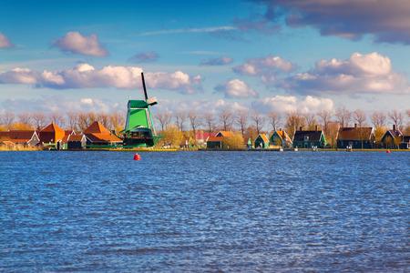 zaandam: Authentic Zaandam mills on the water channel in Zaanstad willage. Zaanse Schans Windmills and famous Netherlands canals.