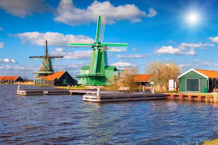 zaandam: Authentic Zaandam mills on the water channel in Zaanstad willage. Zaanse Schans Windmills and famous Netherlands canals, Europe