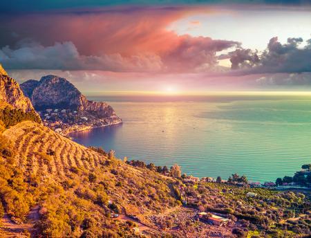 lomography: Colorful spring sunrise on the Zafferano cape, Sicily, Italy, Medityrrhenian sea, Europe.  Lomography stylization and instagram toning effect.