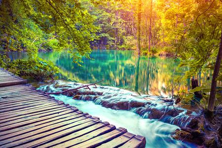 lomography: Colorful autumn sunrise in the Plitvice Lakes National Park. Croatia. Europe. Lomography stylization and instagram toning effect. Stock Photo