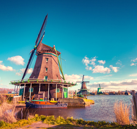 zaandam: Authentic Zaandam mills on the water channel in Zaanstad village. Zaanse Schans Windmills and famous Netherlands canals, Europe. Instagram toning.