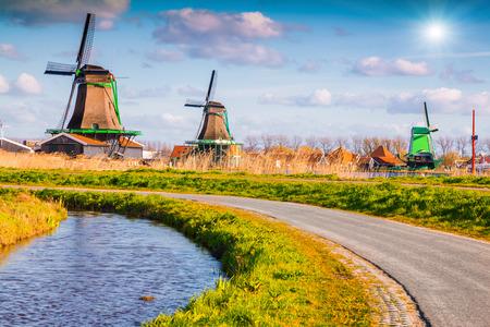 zaandam: Authentic Zaandam mills on the water channel in Zaanstad village. Zaanse Schans Windmills and famous Netherlands canals, Europe