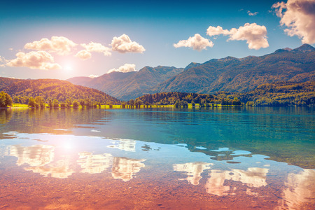 lomography: Colorful summer morning on the Bohinj lake in Triglav national park Slovenia, Julian Alps, Europe. Lomography stylization and instagram toning effect. Stock Photo