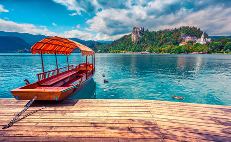 lake: Lake Bled (Blejsko jezero) is a glacial lake in the Julian Alps in northwestern Slovenia, where it adjoins the town of Bled and is overlooked by Bled Castle. Instagram toning.