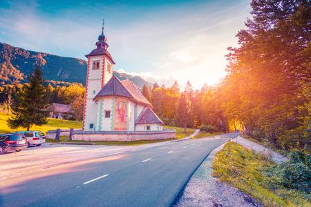 lomography: Church of the Holy Virgin Mary in Ribchev Laz village. Bohinj Lake, Triglav national park Slovenia, Julian Alps, Europe. Lomography stylization and instagram toning effect.