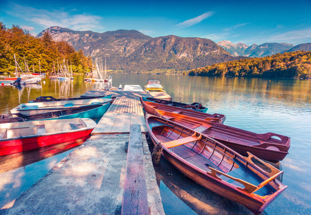 Colorful summer morning on the Bohinj Lake with boats, Triglav National Park, Julian Alps, Slovenia.  Zdjęcie Seryjne
