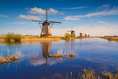 Colorful spring morning on the canal in Netherlands. Dutch windmills at Kinderdijk,
