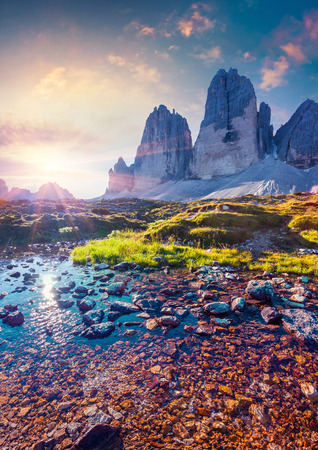 summer landscape: Colorful summer sunrise on the lake Rienza - Ursprung in National Park Tre Cime di Lavaredo. Dolomites, South Tyrol. Location Auronzo, Italy, Europe. Stock Photo