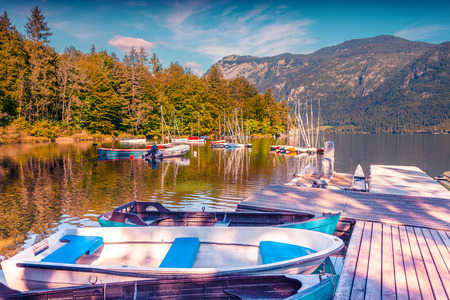 lomography: Colorful summer morning on the Bohinj Lake with boats, Triglav National Park, Julian Alps, Slovenia. Lomography stylization