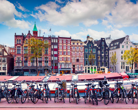 amsterdam: Colorful spring morning in the Amsterdam. Authentic Dutch architecture in the capital and most populous city of the Netherlands.