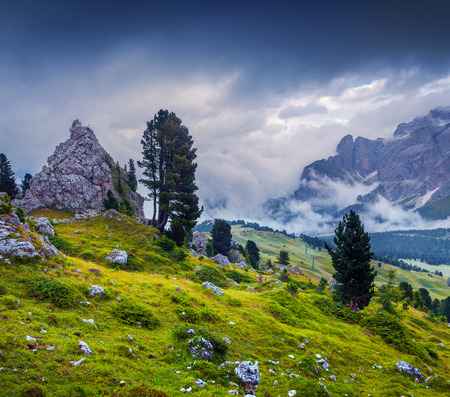 odle: Foggy sunny morning on the Val Gardena valley. View from the Sella pass. National Park Odle Geisler. Dolomites, South Tyrol. Italy, Europe.