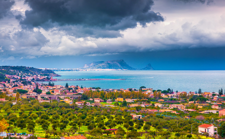 Rain clouds over the northern coast of Sicily. View from the birds eye of Termini town and Zafferano cape. Mediterranean sea, Italy, Europe.