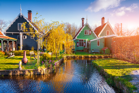 dutch typical: Tipical Dutch village Zaanstad in spring sunny morning. Netherlands, Europe. Stock Photo
