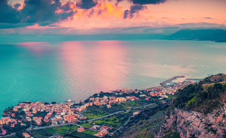 serenity: A birds eye view of the Solanto village. Colorful spring sunset, province Palermo, Sicily, Italy, Europe. Instagram toning.