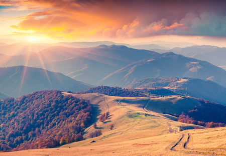 Colorful autumn sunrise in the Carpathian mountains. Krasna ridge, Ukraine, Europe. Banco de Imagens