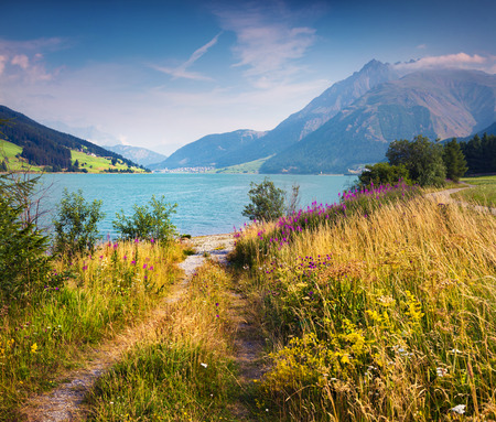 st  valentin: Colorful summer morning on Resia lake in the Italian Alps. Place is located near the village St. Valentin, Alps, Italy, Europe. Stock Photo