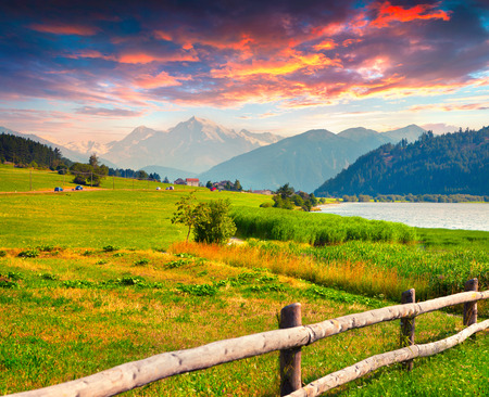 sunrise mountain: Colorful summer sunrise on the lake Muta (Haidersee). Place is located near the village St. Valentin, Alps, Italy, Europe. Stock Photo