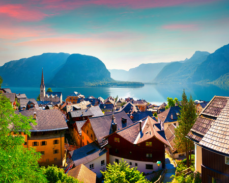 adventure holiday: Colorful summer morning in the Hallstatt village in the Austrian Alps. Maria am Berg church and Hallstattersee lake, Austria, Europe.