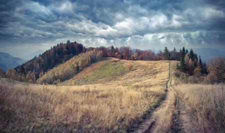 treck: Misty autumn morning in the Carpathian mountains. Kostricha ridge, Ukraine, Europe. Retro style.