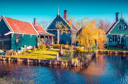zaandam: Authentic Holland architecture on the water channel in Zaanstad village. Zaanse Schans Windmills and famous Netherlands canals, Europe. Instagram toning.