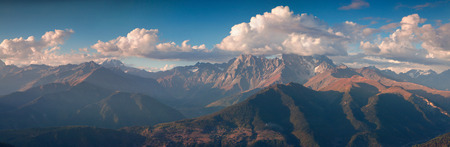 swanetia: Panorama of the Main Caucasus ridge with Ushba mountain in the cloud.  Upper Svaneti, Georgia, Europe. October 2015. Stock Photo
