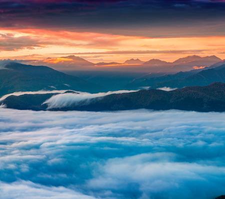 swanetia: Foggy autumn morning at the foot of Mt. Tetnuld. Upper Svaneti, Mestia, Georgia, Europe. Caucasus mountains. October 2015.