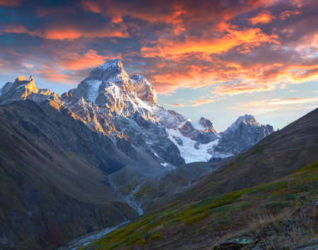 swanetia: Colorful autumn sunrise in the Caucasus mountains. Upper Svaneti, Main Caucasus ridge, Georgia, Europe. October 2015. Stock Photo