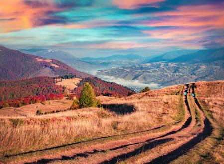treck: Colorful autumn sunrise in the Carpathian mountains. Krasna ridge, Ukraine, Europe.