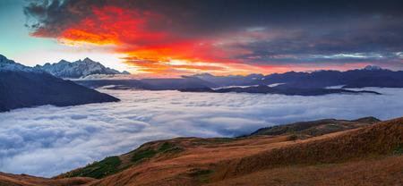 svan: Foggy autumn morning at the foot of Mt. Tetnuld. Upper Svaneti, Mestia, Georgia, Europe. Caucasus mountains. October 2015.