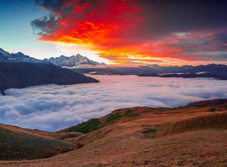mestia: Foggy autumn morning at the foot of Mt. Tetnuld. Upper Svaneti, Mestia, Georgia, Europe. Caucasus mountains. October 2015.
