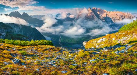 amazing stunning: Gruppo Del Cristallo mountain range at foggy summer morning. National Park Tre Cime di Lavaredo. Dolomites, South Tyrol. Location Auronzo, Italy, Europe.
