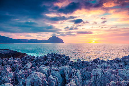 Colorful spring sunset on the nature reserve Monte Cofano, San Vito cape. Sicilia, Italy, Europe. Mediterranean sea. Instagram toning. Stock Photo