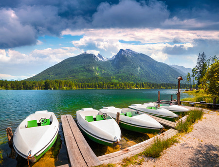 fishing pier: Colorsul summer scene on the Hintersee lake with white pleasure launches in Austrian Alps. Salzburg-Umgebung, Austria, Europe.