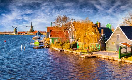 zaandam: Fantastic spring view of Dutch architecture on the water channel in Zaanstad village. Zaanse Schans Windmills and famous Netherlands canals, Europe.