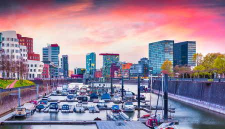 and germany: Colorful spring sunset on Rhine in Dusseldorf. Medienhafen in the soft evening light, Nordrhein-Westfalen, Germany, Europe.