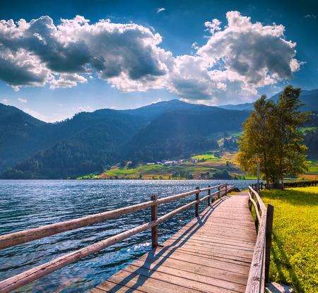 st valentin: Summer morning scene on the Muta lake (Haidersee). Park is located near the St. Valentin village in Italian Alps. Bolzano, South Tyrol, Italy, Europe.