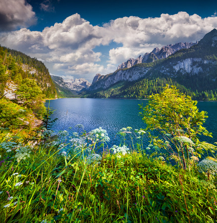 Sunny summer morning on the Gosau Lake (Vorderer Gosausee) with view of Hoher Dachstein and Gosau glacier in Upper Austrian Alps, Salzkammergut region, Austria.