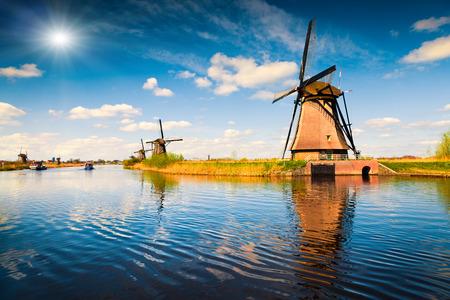 Summer scene in the famous Kinderdijk canal with windmills. Old Dutch village Kinderdijk, UNESCO world heritage site. Netherlands, Europe. Stock Photo