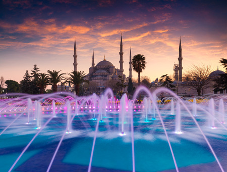 borne fontaine: Colorful spring sunset in Sultan Ahmet park in Istanbul, Turkey, Europe. Colorful fountain on the background of the Loonic Blue Mosque. Artistic style post processed photo.