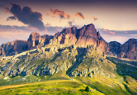 Colorful summer scene in southern slope of Piz Boe mountain range. Sunrise in Dolomite Alps, view from Pordoi pass, Canazei location, Trentino, Italy, Europe.