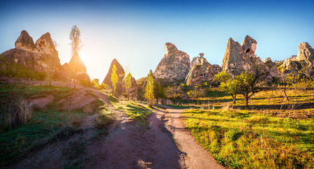 castle district: Unreal world of Cappadocia. Early morning in the Uchisar Castle neighborhood. Sunrise in famous Uchisar village, district of Nevsehir Province in the Central Anatolia Region of Turkey, Asia. Stock Photo