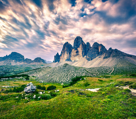 Fantastic colors landscape in the National Park Tre Cime di Lavaredo. Summer sunrise in Dolomite Alps, South Tirol. Location Auronzo, Italy, Europe.