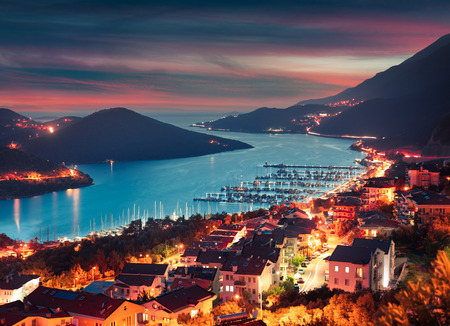 View from the birds eye of the Kas city, district of Antalya Province of Turkey, Asia. Colorful spring sunset in small Mediterranean yachting and tourist town. Banco de Imagens