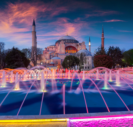 borne fontaine: Colorful spring sunset in Sultan Ahmet park in Istanbul, Turkey, Europe. Colorful fountain on the background of the Ayasofya Museum (Hagia Sophia). Artistic style post processed photo.