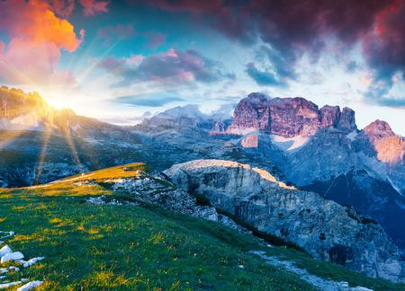 Colorful summer sunrise on Gruppo del Cimonega mountain range in National Park Tre Cime di Lavaredo. Dolomite, South Tyrol. Location Auronzo, Italy, Europe. Stock Photo