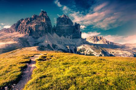 Colorful summer scene in the National Park Tre Cime di Lavaredo with rifugio Auronzo. Dolomites, South Tirol. Location Auronzo, Italy, Europe. Instagram filter toned. Stock Photo