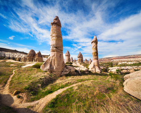 Amazing shapes in sandstone canyon near famous Goreme village, Cappadocia, district of Nevsehir Province in the Central Anatolia Region of Turkey, Asia. Artistic style post processed photo.