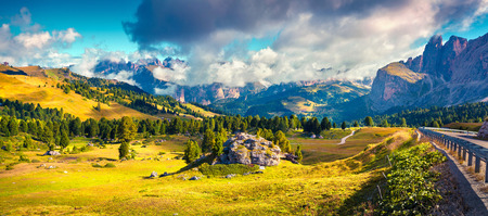 Sunny morning scene in the Val Gardena valley. Colorful panorama from Sella pass in National Park Odle Geisler. Landscape of Dolomite Alps, South Tyrol. Italy, Europe.