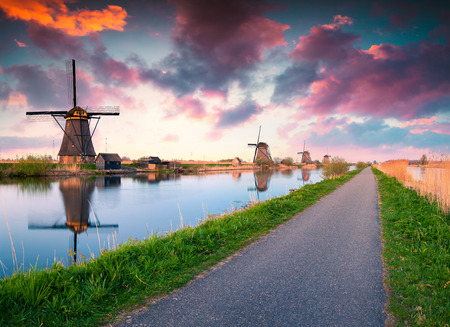 Colorful spring scene in the famous Kinderdijk canals with windmills Stock Photo