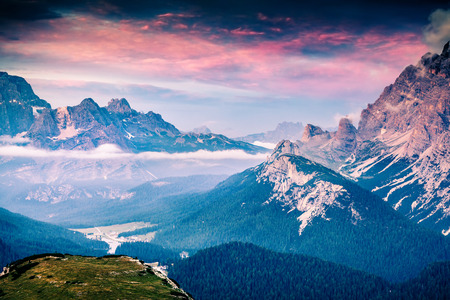 Colorful summer scene in the National Park Tre Cime De Lavaredo. View from birds eye of Misurina lake. Dramatic sunrise in Dolomite Alps. Location Auronzo, Italy, Europe.